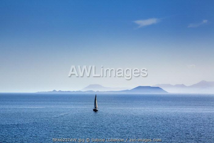 Sailing boat and Fuerteventura, from Playa Blanca, Lanzarote, Canary Islands, Spain