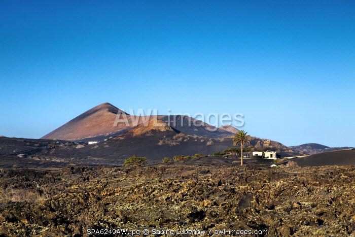 House in volcanic landscape, Parque de los Volcanes, Lanzarote, Canary Islands, Spain
