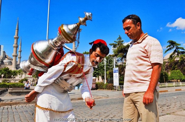 Turkey, Istanbul, Sultanahmet District, water seller in front of Aya Sofya (Hagia Sophia)