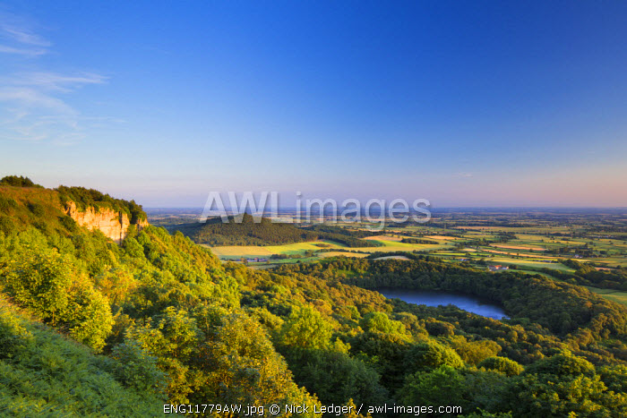 United Kingdom, England, North Yorkshire, Sutton Bank. The classic view of Lake Gormire from Whitestone Cliffs.
