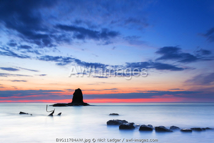 United Kingdom, England, North Yorkshire, Whitby. The wreck of the Admiral von Tromp and the sea stack known as Black Nab at Saltwick Bay.
