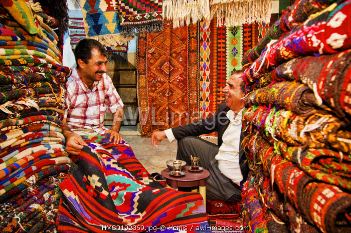 Turkey, Eastern Anatolia, Sanliurfa, bazaar, carpet seller