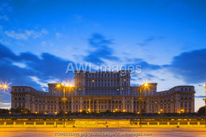 Romania, Bucharest. The Palace of the Parliament a dusk. Also known as the House of the People it is the second largest administrative building in the world after the Pentagon.