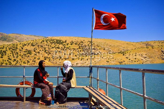 Turkey, Eastern Anatolia, Nemrut Dagi (Mount Nemrut), listed as World Heritage by UNESCO, young Kurd women on the ferry which crosses Lake Nemrut