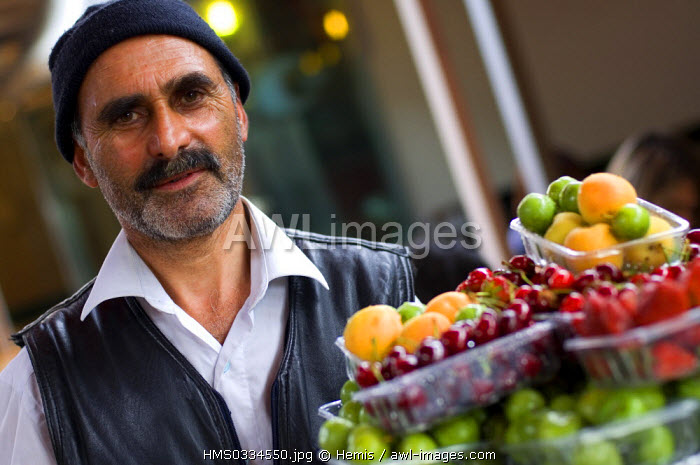 Turkey, Istanbul, Tophane District, portrait of a man carrying fruit