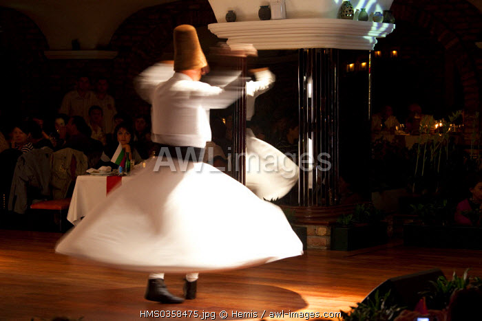 Turkey, Istanbul, Beyazit District, whirling dervish in a restaurant for tourists
