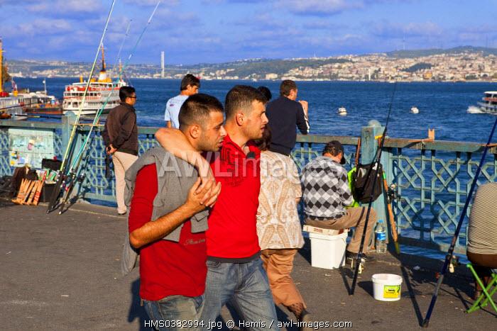 Turkey, Istanbul, Eminonu District, Galata Bridge over the Golden Horn Strait, couple of men