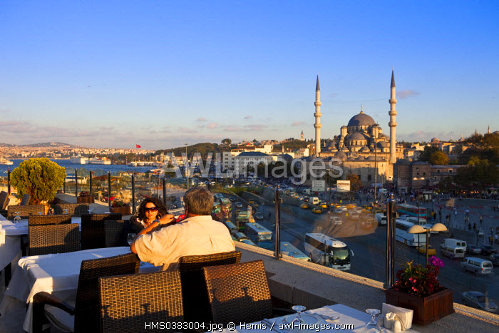 Turkey, Istanbul, Eminonu District, restaurant terrace, in the background the Yeni Cami (New Mosque) in the historical centre listed as World Heritage by UNESCO