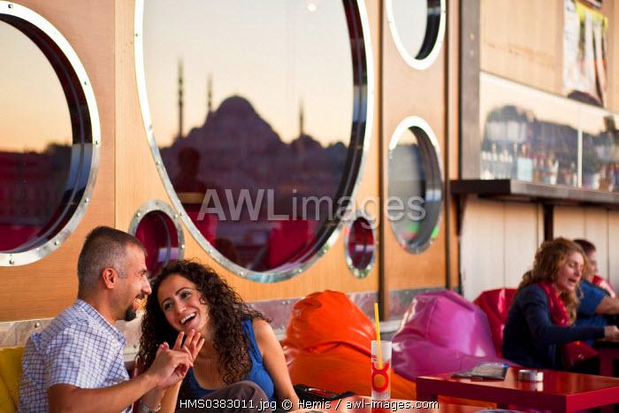 Turkey, Istanbul, Eminonu District, restaurants and trendy cafes under the Galata Bridge over the Golden Horn Strait