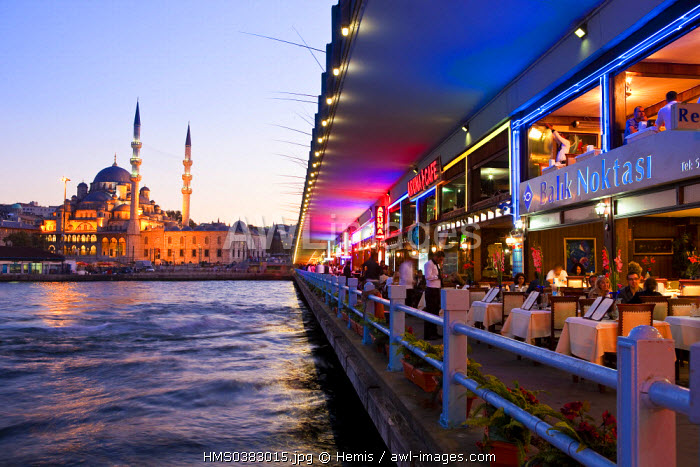 Turkey, Istanbul, Eminonu District, restaurants and trendy cafes under the Galata Bridge over the Golden Horn Strait, in the background the Yeni Cami (New Mosque) in the historical centre listed as World Heritage by UNESCO