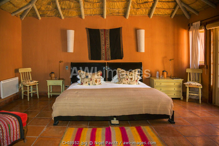 Chile, San Pedro de Atacama, Antofagasta Region, El Loa Province. A hotel bedroom at Awasi Atacama, one of several boutique tourist hotels situated in San Pedro de Atacama.