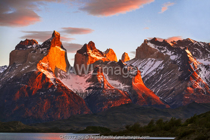 Chile, Torres del Paine, Magallanes Province. Sunrise over the peaks of Cuernos del Paine. The notable formation of contrasting igneous, sedimentary and metamorphic rocks is unique in the world.