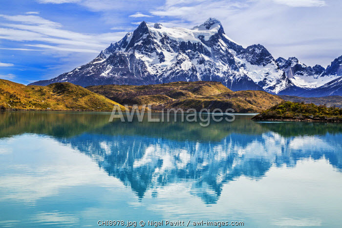 Chile, Torres del Paine, Magallanes Province. Cerro Paine Grande reflected in Lake Pehoe.  One of the principal attractions of Torres del Paine National Park is the magnificent Paine massif.