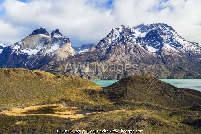 Chile, Torres del Paine, Magallanes Province. A scenic view in the Torres del Paine National Park with Lake Nordenskjold below the peaks of Cuernos del Paine and Almirante Nieto of the magnificent Paine Massif.