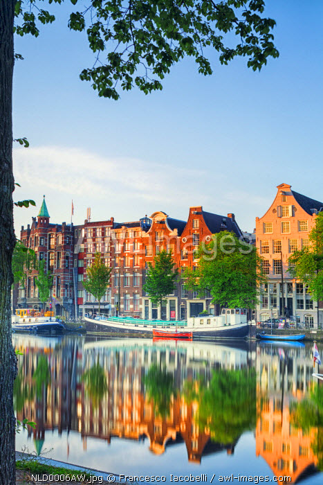 Netherlands, North Holland, Amsterdam. Typical houses and houseboats on Amstel river.