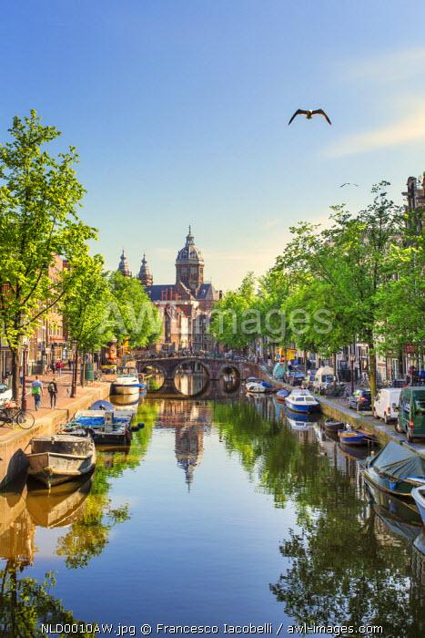 Netherlands, North Holland, Amsterdam. Oudezijds Achterburgwal Canal and Saint Nicholas Church (St Nicolaas Kerk)