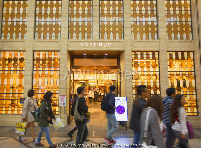 People walking past shop in shopping arcade in Shinsaibashi, Osaka, Kansai, Japan
