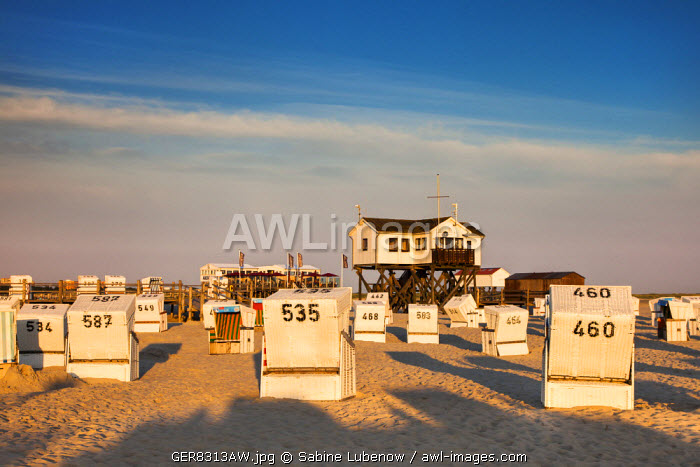 Beach baskets and stilt house, St. Peter-Ording, Eiderstedt peninsula, Northern Frisia, Schleswig-Holstein, Germany