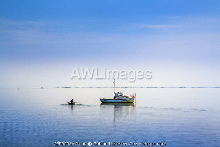 Boat in clam sea, Hallig Langeness, Northern Frisia, Schleswig-Holstein, Germany