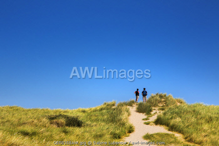 Two people in the dunes, Sylt Island, Northern Frisia, Schleswig-Holstein, Germany