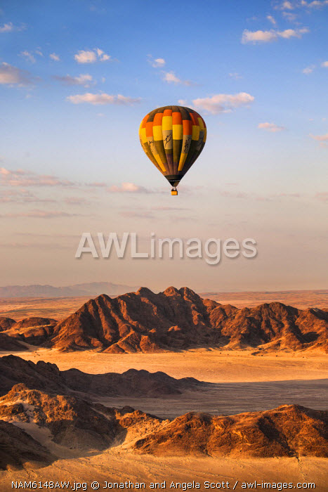 Africa, Namibia, Namib Desert, Sossusvlei. Hot air balloon floating over the Sossusvlei.