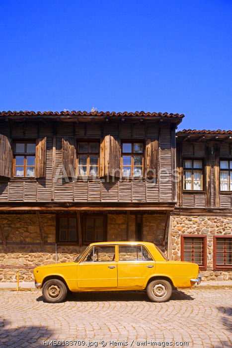 Bulgaria, Black Sea region, Sozopol, old Lada car parked in front of a wooden house
