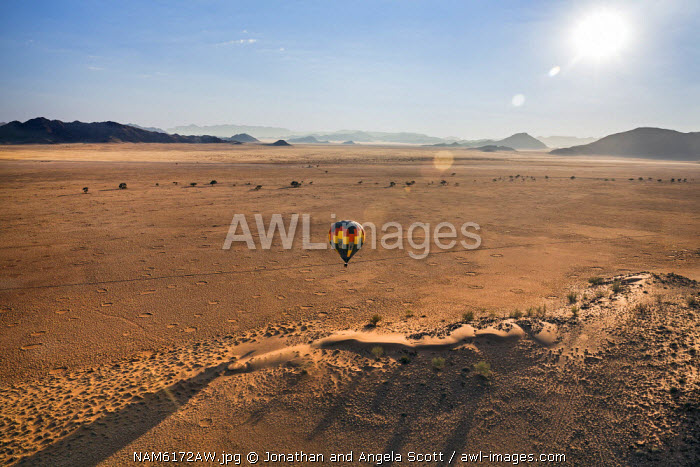 Africa, Namibia, Namib Desert, Sossusvlei. Hot air balloon floating over the Sossusvlei.