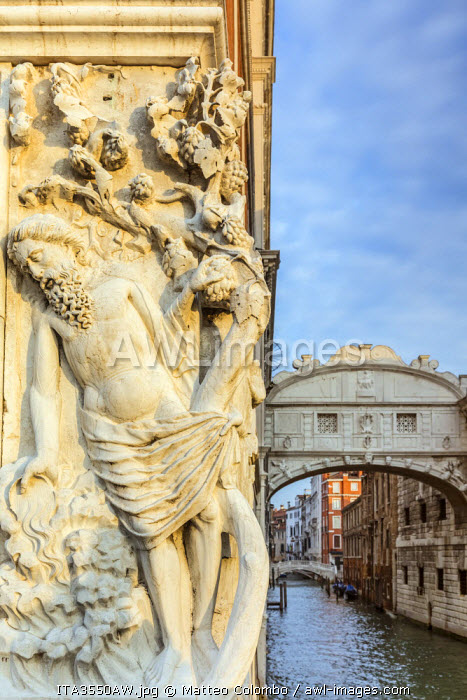 Italy, Veneto, Venice. Bridge of sighs and sculpture entitled Drunkenness of Noah