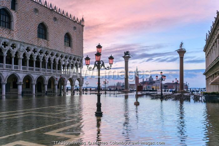 Italy, Veneto, Venice. Acqua Alta in St Marks square at sunrise
