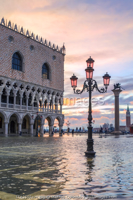 Italy, Veneto, Venice. Acqua Alta in St Marks square at sunrise