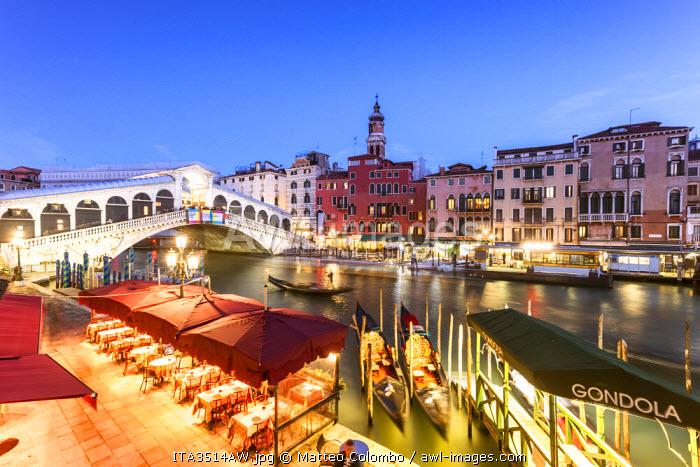 Italy, Veneto, Venice. Rialto bridge at dusk, high angle view