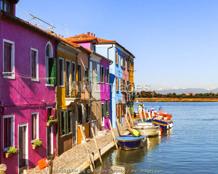 Italy, Veneto, Venice, Burano. Colourful houses near canal