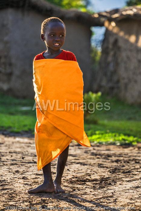 Africa, Kenya, Narok County, Masai Mara. A young Maasai boy at his homestead.