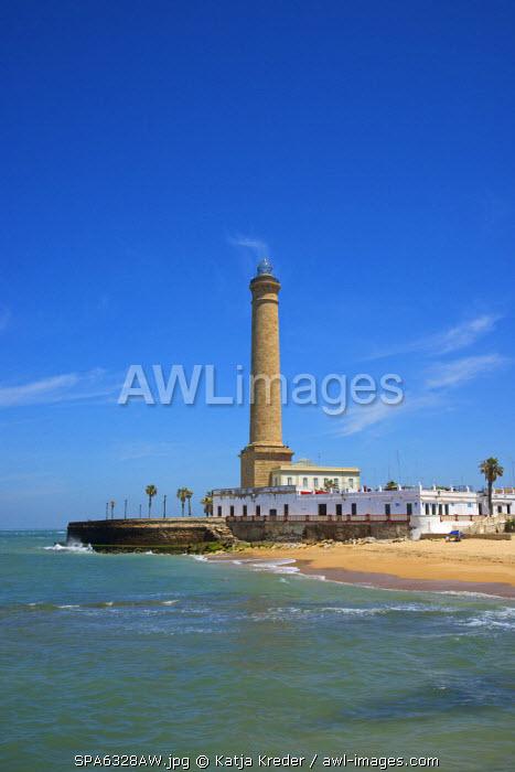 Beach and lighthouse of Chipiona, Costa de la Luz, Andalusia, Spain