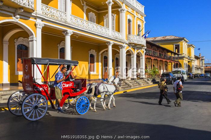 Nicaragua, Granada department, Granada, colonial buildings around the Parque Central (or Parque Colon), horse cart transport