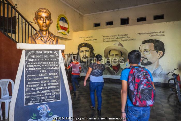 Nicaragua, Leon department, Leon, the entrance of the CUUN building (Centro Universitario de la Universidad Nacional) where the FSLN (Frente Sandinista de Liberacion Nacional) was founded, in the background the portraits of Sandino, Che Guevara and Fonseca