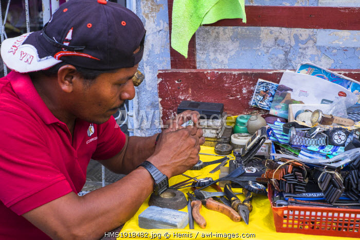 Nicaragua, Leon department, Leon, watch repairer in the street