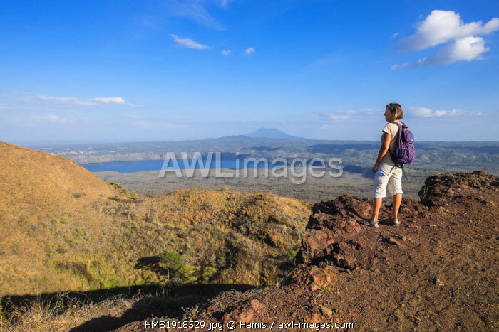 Nicaragua, Masaya departement, Masaya, National Park of Volcano Masaya, hiking on the edges of the crater San Fernando, view over the Laguna de Masaya and the volcano Mombacho