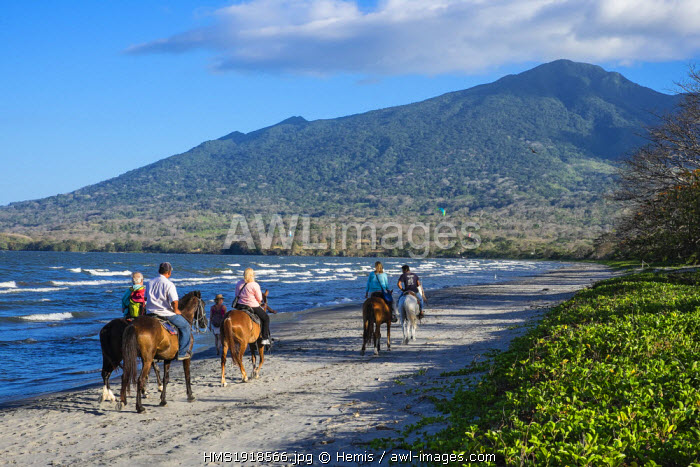 Nicaragua, Rivas department, Ometepe island, the shore of lake Nicaragua (or lake Cocibolca), horse ride on Santo Domingo beach, volcano Maderas in the background