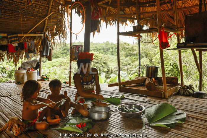 Panama, Darien province, Darien National Park, listed as World Heritage by UNESCO, Embera indigenous community, portrait of an Embera indigenous family in their home