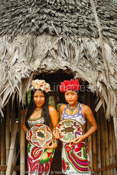 Panama, Darien province, Darien National Park, listed as World Heritage by UNESCO, Embera indigenous community, portrait of two young indigenous Embera girls wearing crafts for visitors