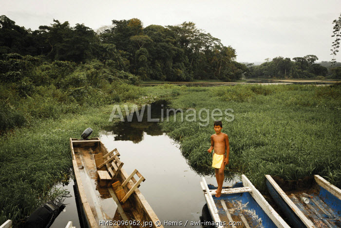 Panama, Darien province, Darien National Park, listed as World Heritage by UNESCO, Embera indigenous community, boy on a fishing boat in a lake