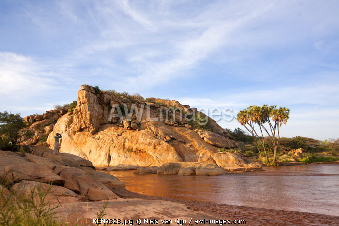 Kenya, Shaba National Park. A guide overlooks the Ewaso Ng'iro River in Shaba National Park.