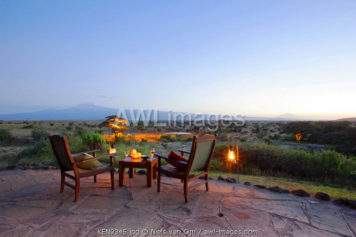 Kenya, Amboseli National Park, Tortilis Camp. Sundowner set for two, overlooking Mount Kilimanjaro.