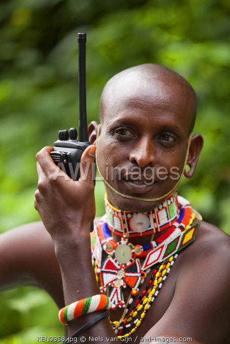 Kenya, Mathew's Mountain Range. A Samburu Guide checks in with camp on his walky talky.