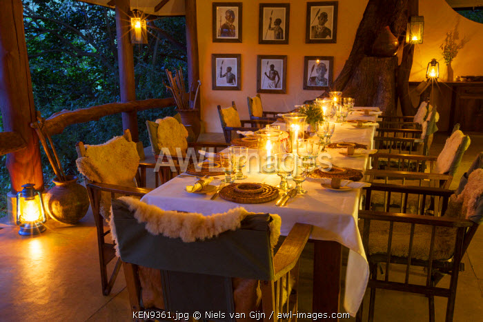 Kenya, Mathew's Mountain Range. Kitich Camp dining table, laid for dinner.