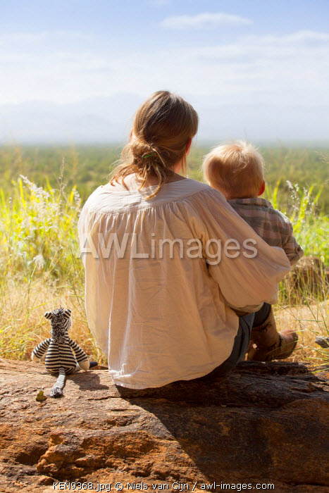 Kenya, Meru National Park. Mother and son overlook Meru National Park. MR.