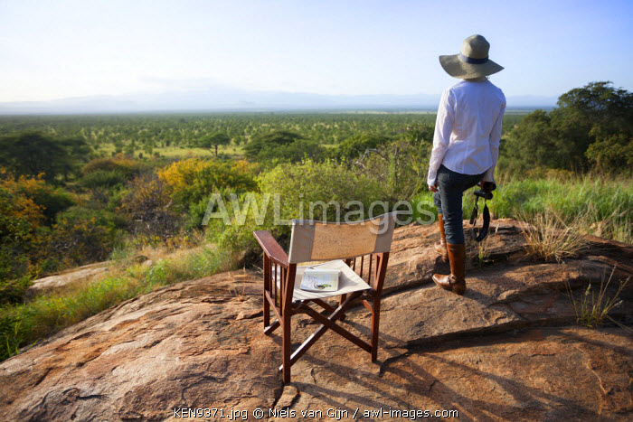 Kenya, Meru National Park. A young lady looks out over Meru National Park. MR