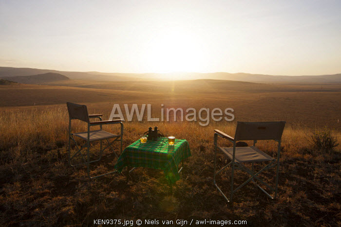 Kenya, Lewa Conservancy. Sundowner overlooking the plains of Lewa.