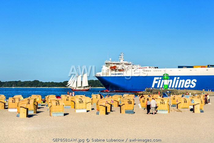 Ferry and sailing boat near beach, Travemünde, Lübeck, Baltic coast, Schleswig-Holstein, Germany